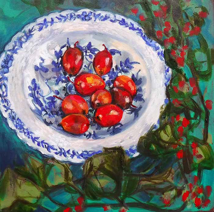 A square oil painting of crab apples in a blue and white china bowl; the view is from above looking down, so the bowl looks reminiscent of a nest with jewel like eggs and takes up much of the canvas, a vine of Bryony with bright red berries winds down the right and bottom of the picture, framing the bowl. The background is an emerald green, the fruit is focussed with looser strokes for the bowl and looser still for the Bryony leaves, the berries are loose stabs of scarlet red against the green .