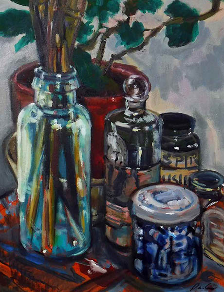 A rectangular oilp painting of artists materials painted in loose brush strokes; a chunky old glass bottle with paintbrushes, jars with turps in and other liquid, and a blue and white china pot. In the background is a terracotta plant pot with a geranium plant reaching up into the top of the canvas. The colours are mainly blues and greens with the burnt sienna orange primer showing through in parts as the table cloth.