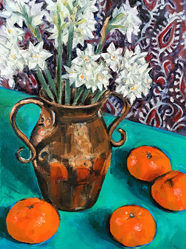 A portrait format still life oil painting by Nina Packer, there are stems of 'Paper Whites', or white narcissi standing in a copper vase with curved handles, on an emerald green surface. There are four satsumas on the table and the background is loosely painted Indian fabric in dark purple and indigo with cream paisley print.