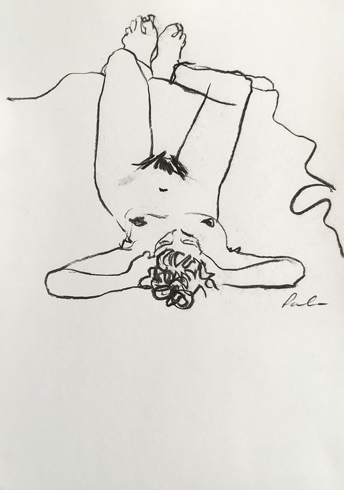 Portrait format charcoal line drawing on paper of female life study by Nina Packer, she is lying down with both legs propped up, we view her with her head in the foreground and legs in the background, the drawing has been done quickly, the first mark laid down the last.