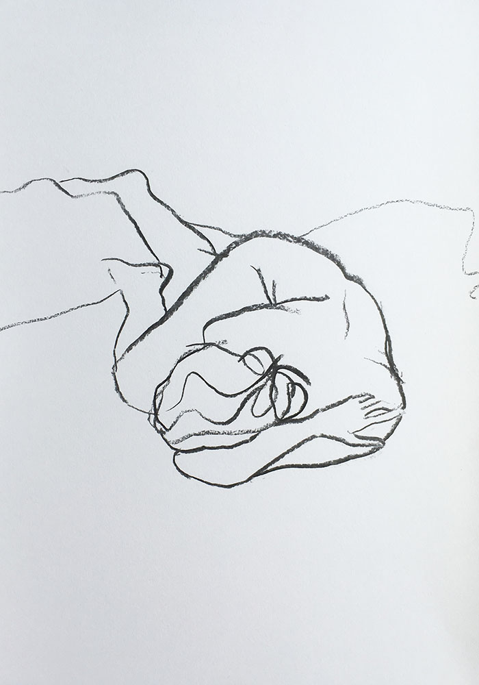 A portrait format line figure life drawing in charcoal by Nina Packer, the female model is lying down with her knees drawn to her chest, the lines are quickly drawn and simple.